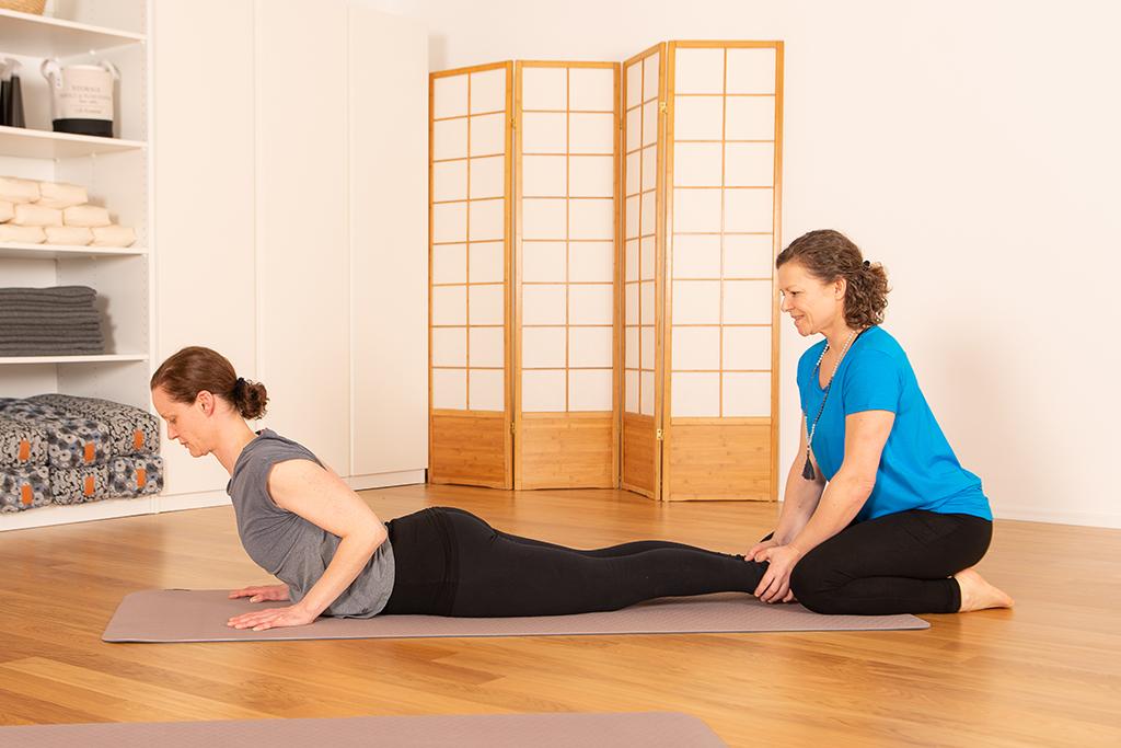 Hilfestellungen im Yoga Coaching